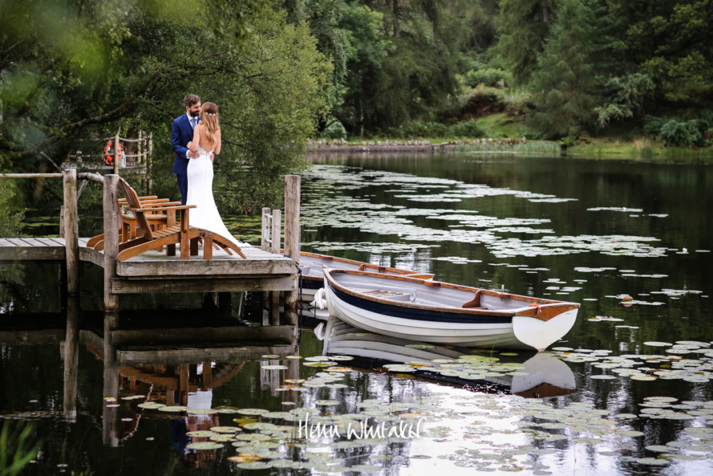 Wedding photographer gilpin lake house - bride & groom on the lake