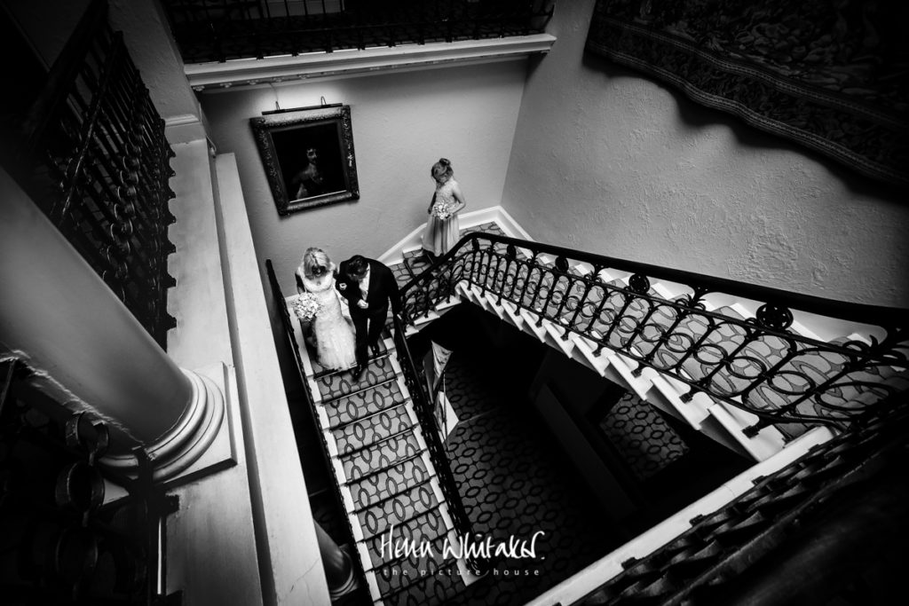 Documentary wedding photographer Storrs Hall stairs Lake District