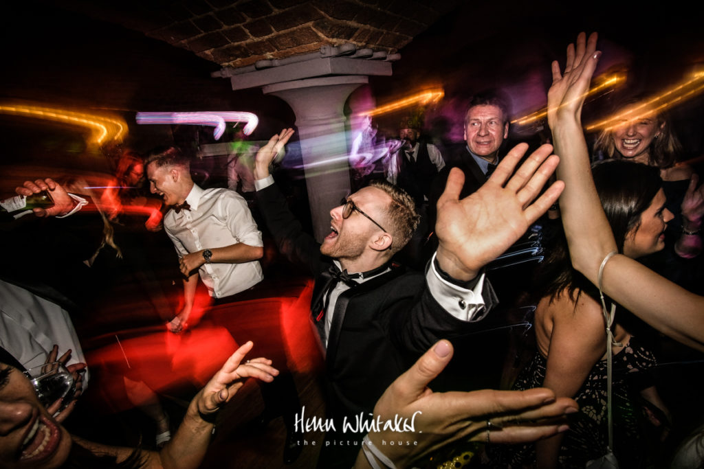 Documentary wedding photographer Matfen Hall Northumberland dancing