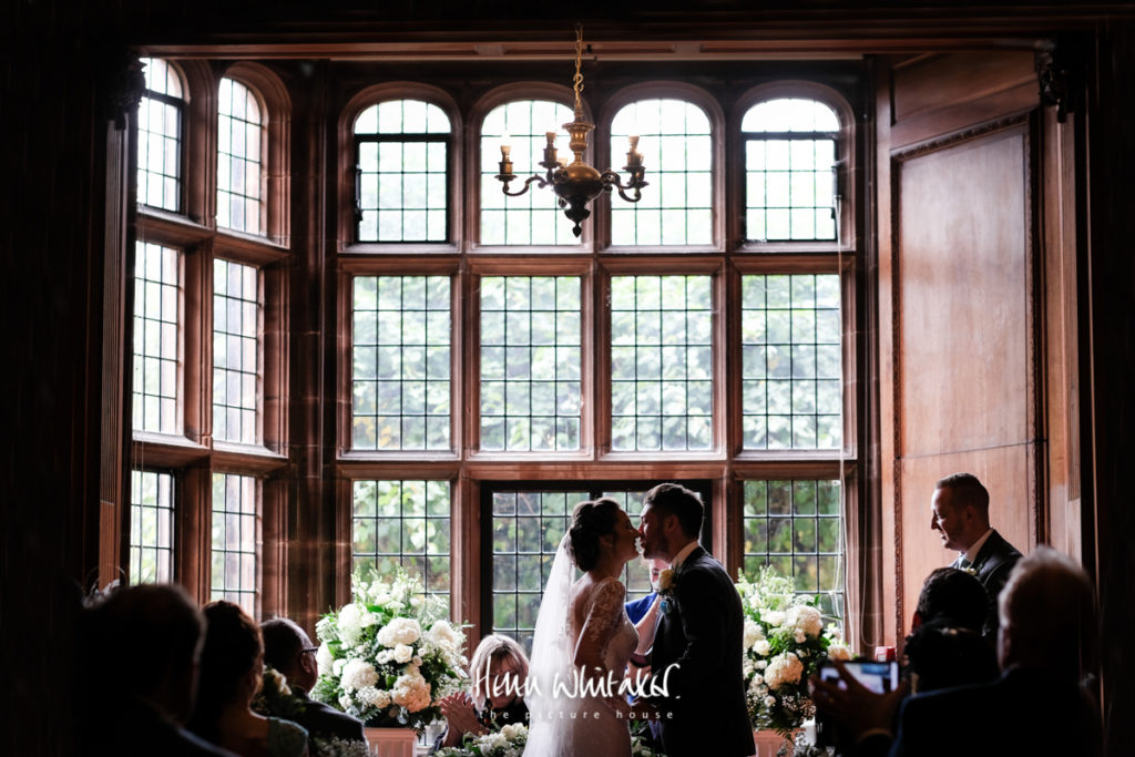 Documentary wedding photographer Thornton Manor Cheshire first kiss