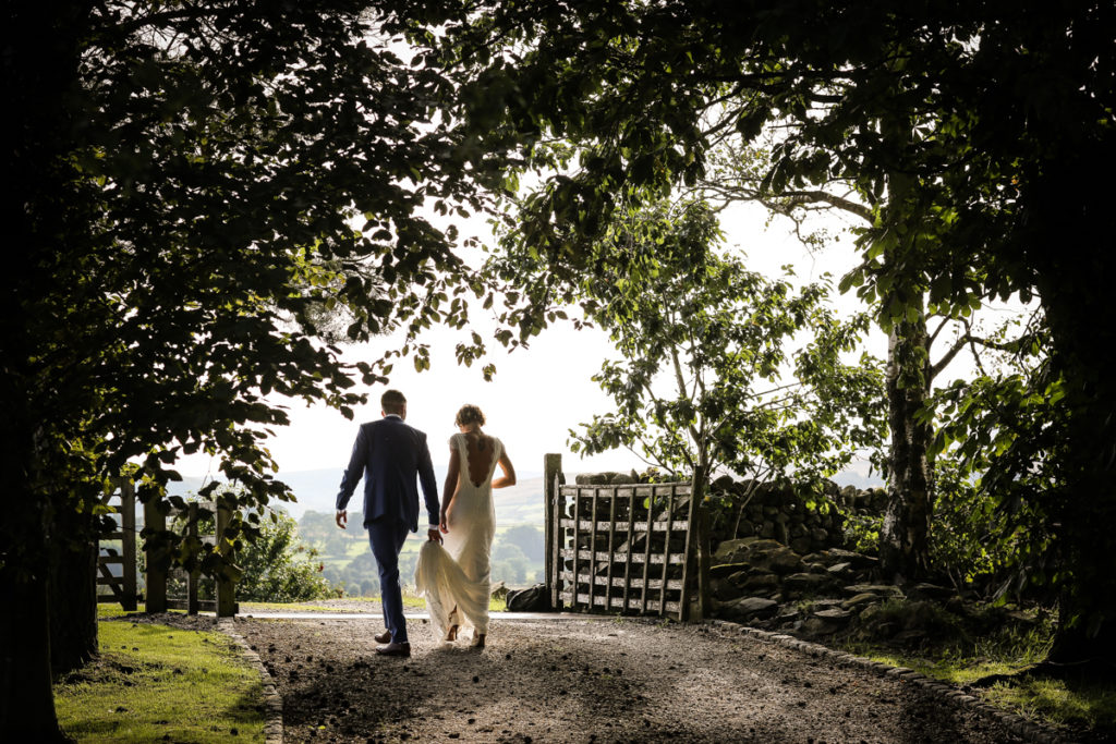 lake district documentary wedding photographer Knipe Hall bride and groom in trees