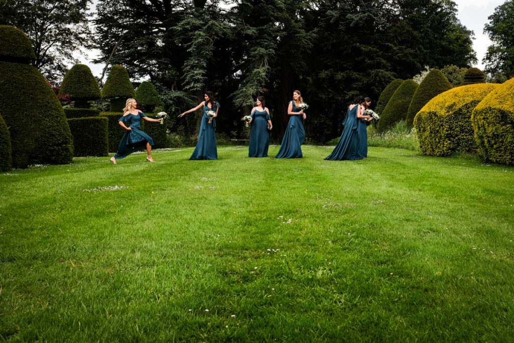 lake district documentary wedding photographer Askham Hall four bridesmaids walking
