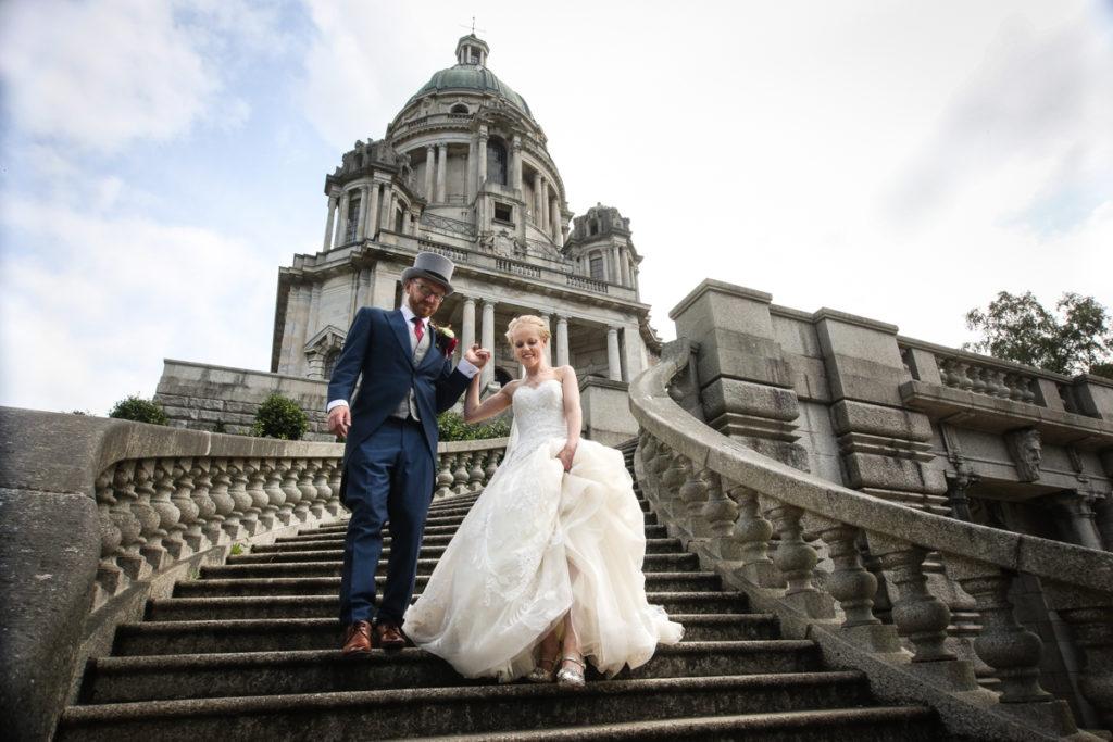 lake district documentary wedding photographer Ashton Memorial couple on steps