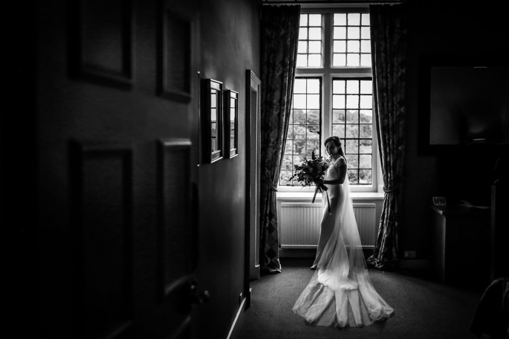 lake district documentary wedding photographer Askham Hall bride in window