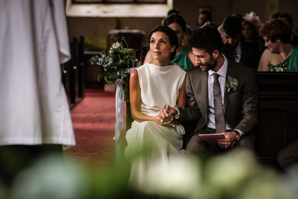 lake district documentary wedding photographer The Rowley Estates couple in church