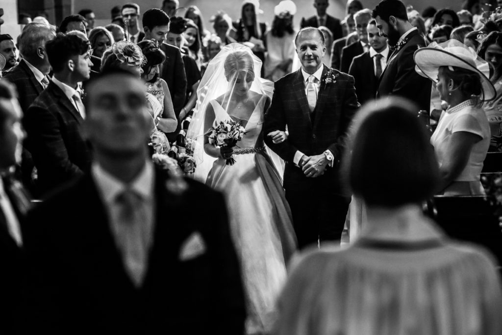lake district documentary wedding photographer father walking his daughter up the aisle