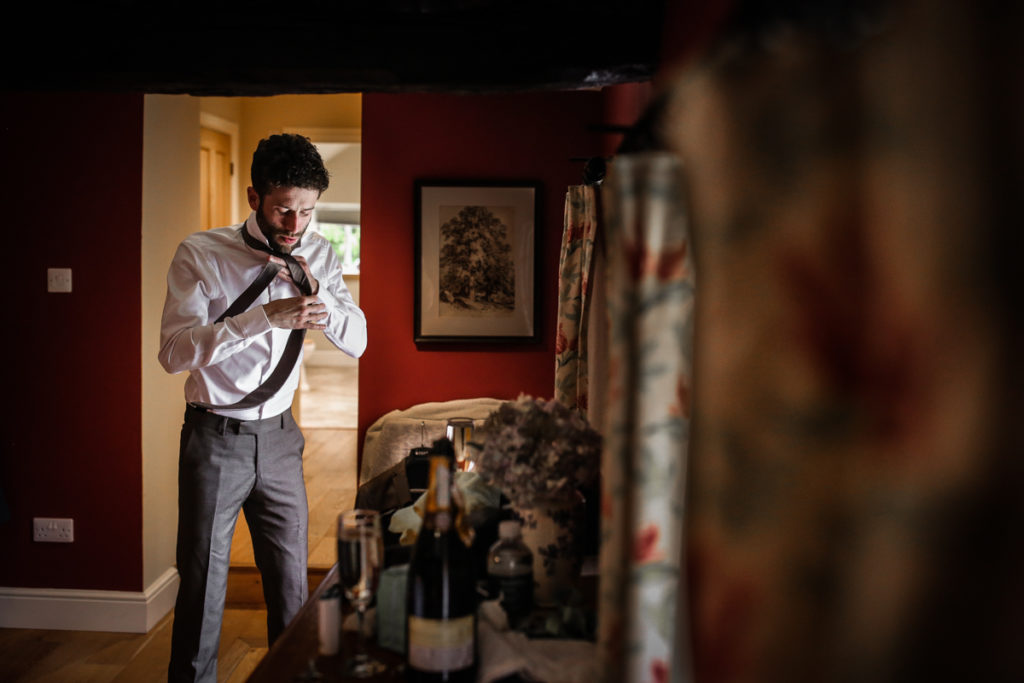 lake district documentary wedding photographer Melmerby Hall groom prep