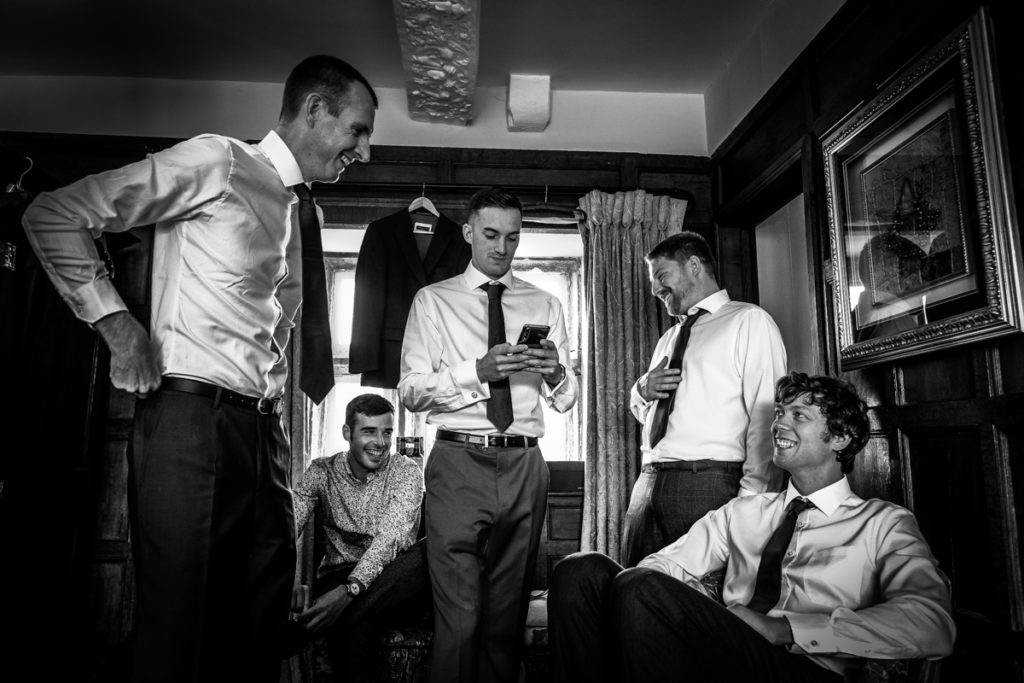 lake district documentary wedding photographer ushers and groom prep in black and white
