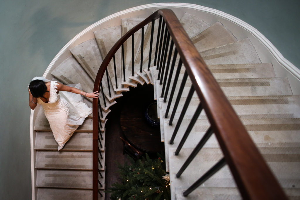 lake district documentary wedding photographer Longlands bride on the stairs