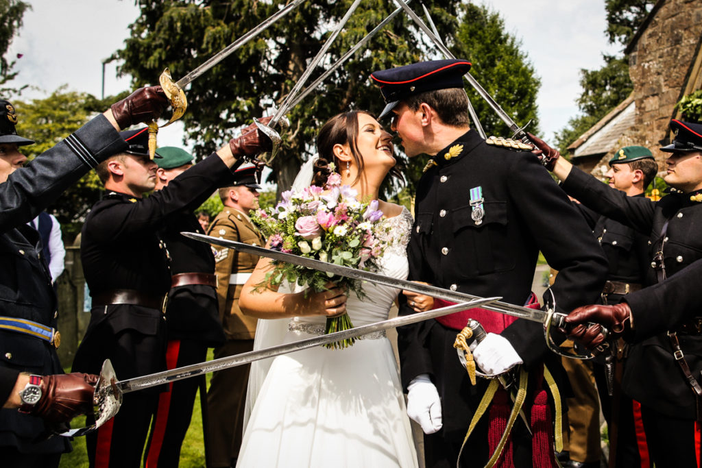 lake district documentary wedding photographer Cumbrian military wedding confetti and swords