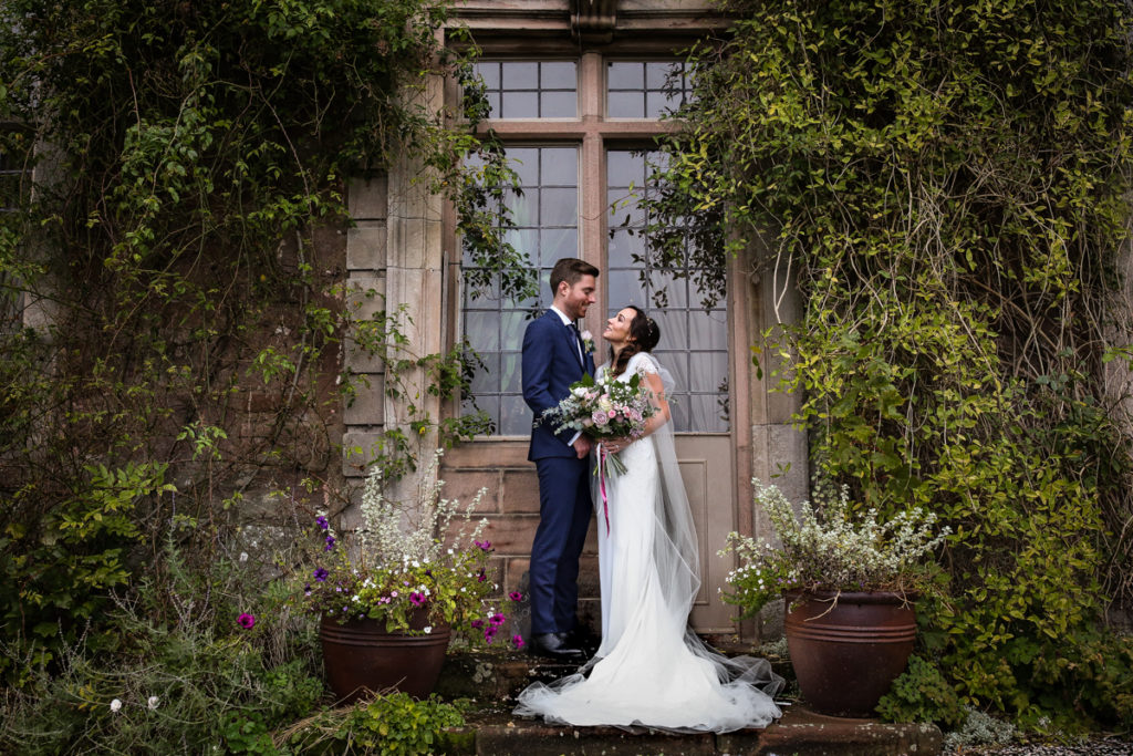 lake district documentary wedding photographer Askham Hall bride and groom portrait by window