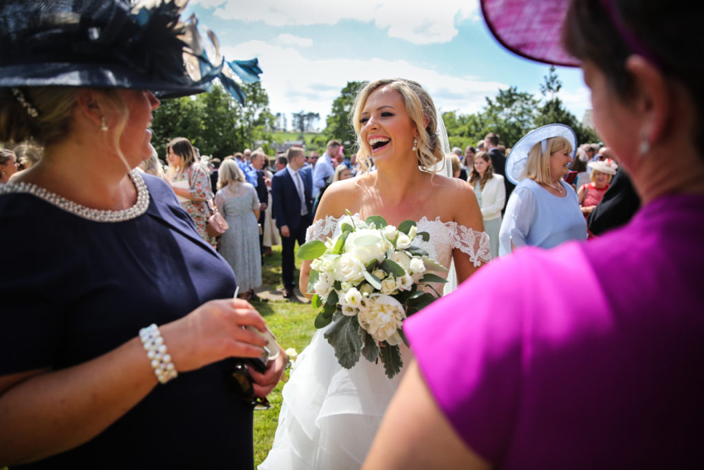 lake district documentary wedding photographer bride and guests in the sunshine