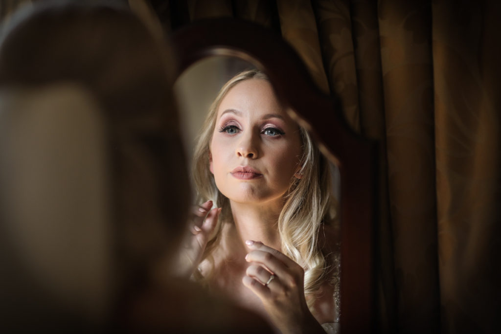 lake district documentary wedding photographer bride in the mirror Armathwaite Hall