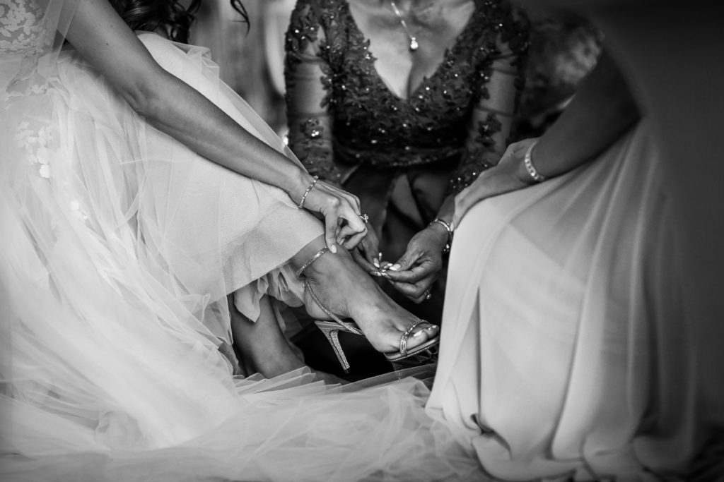 lake district documentary wedding photographer brides shoes in black and white