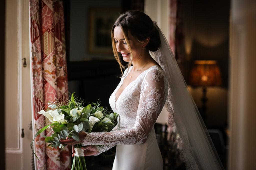 lake district documentary wedding photographer Askham Hall bridal portrait with flowers