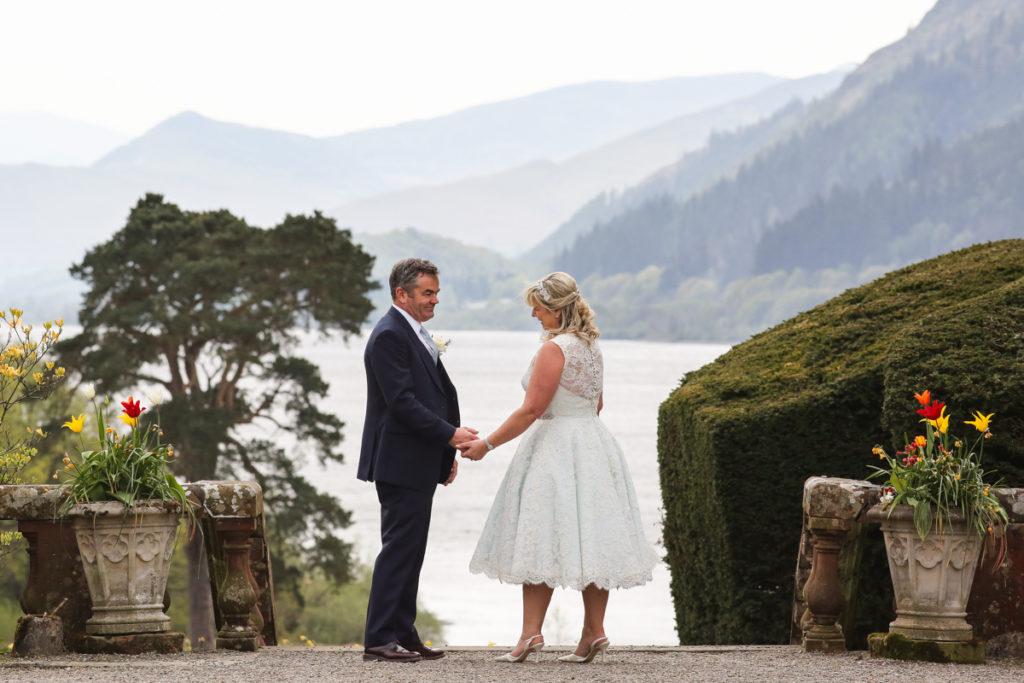 lake district documentary wedding photographer Armathwaite Hall couple in lake view