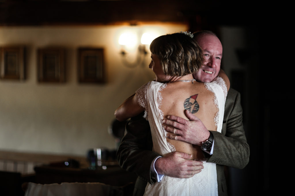 Knipe Hall bride hugging father Lake District wedding photographer