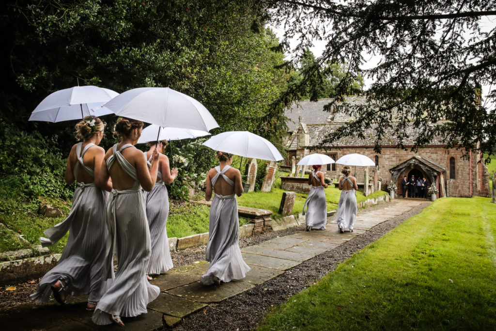 lake district documentary wedding photographer bridesmaids arriving at church