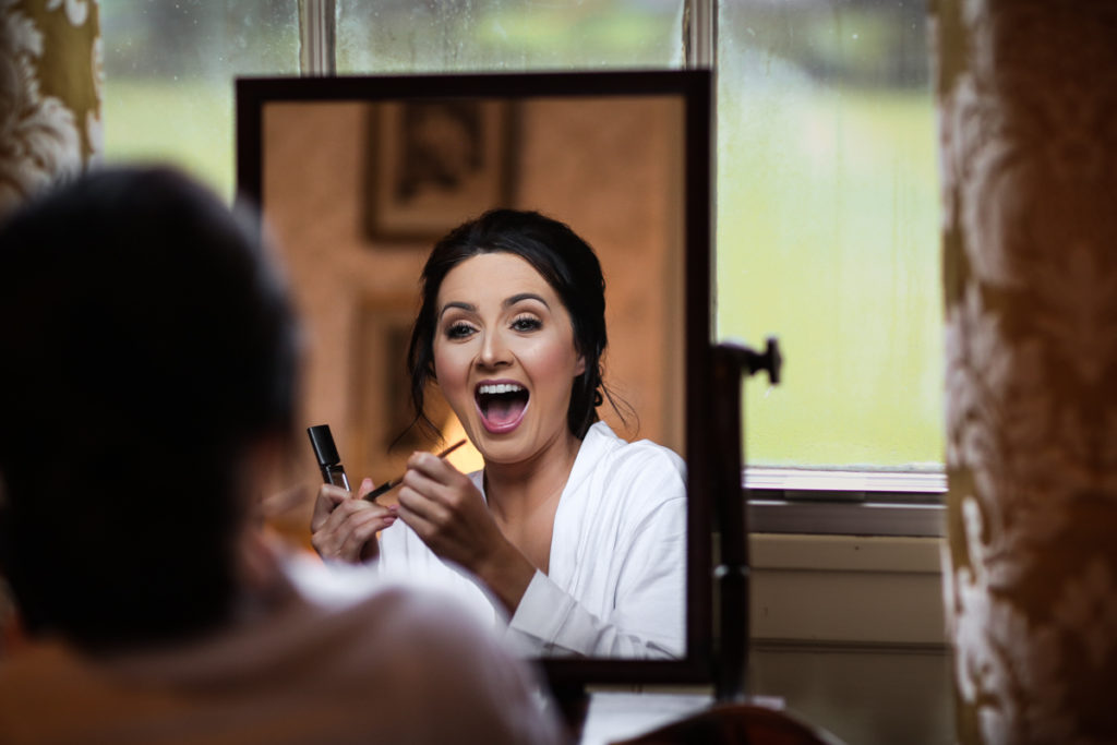 lake district documentary wedding photographer Longlands bride in the mirror