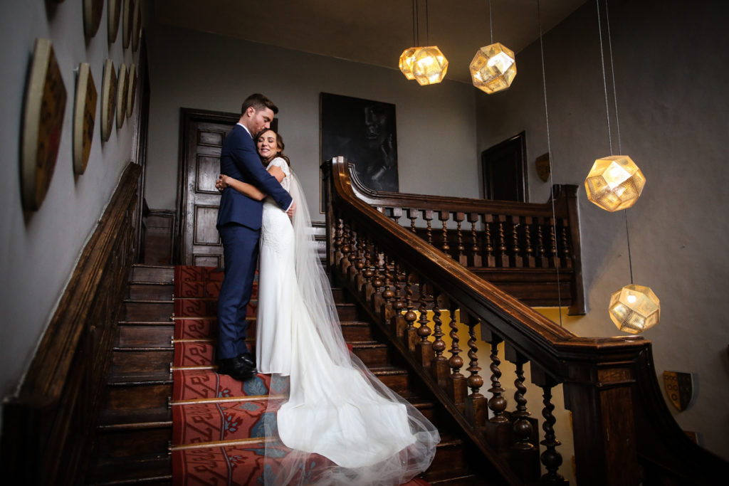 lake district documentary wedding photographer Askham Hall couple on the stairs