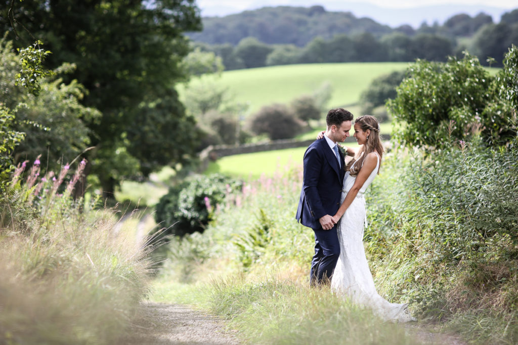 lake district documentary wedding photographer couple portrait in the fields