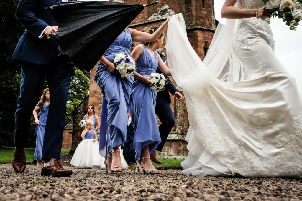 lake district documentary wedding photographer wedding party leaving the church