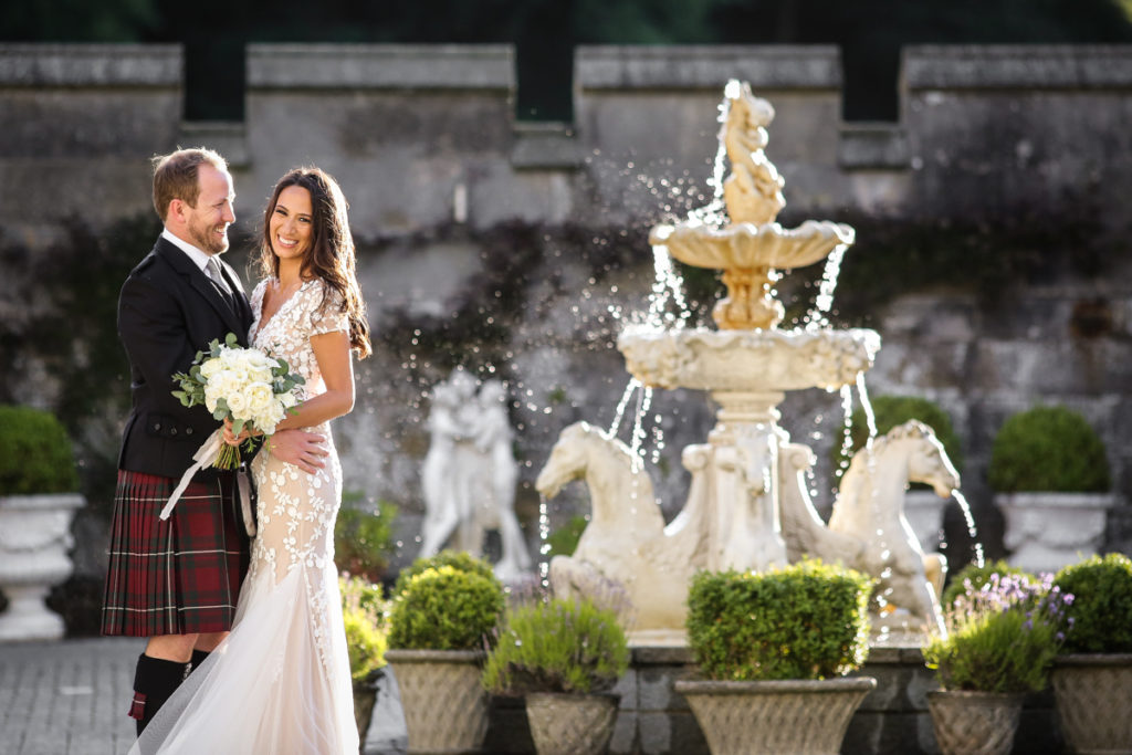 lake district documentary wedding photographer Dundas Castle couple portrait with fountain