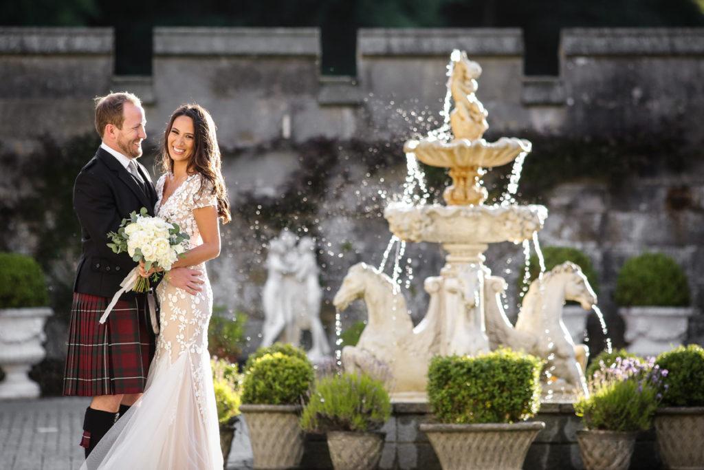 lake district documentary wedding photographer Dundas Castle couple portrait with fountain