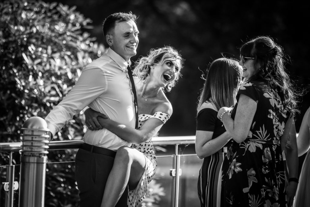 lake district documentary wedding photographer Armathwaite Hall wedding partying guests in black and white