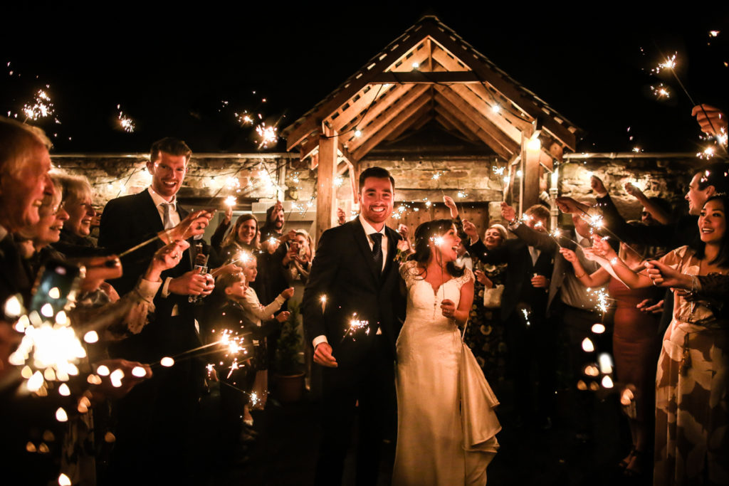 lake district documentary wedding photographer Askham Hall bride and groom sparkler shot