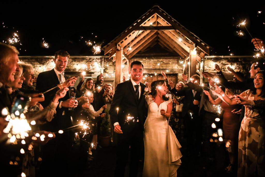 lake district documentary wedding photographer Askham Hall bride and groom sparkler shot