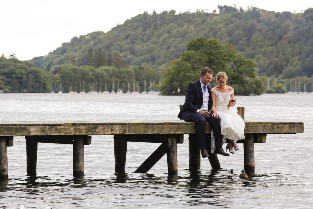 lake district documentary wedding photographer couple on jetty with duck