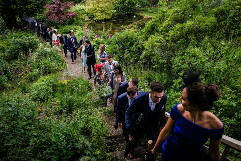 lake district documentary wedding photographer Askham Hall guests walking