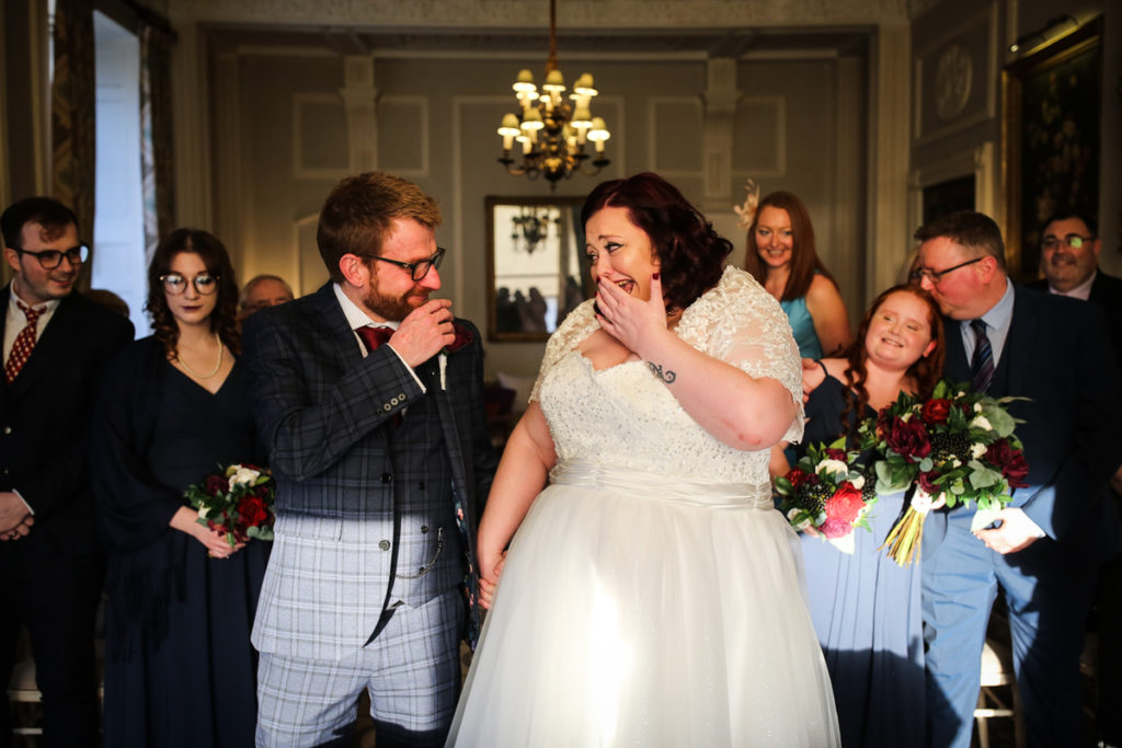 lake district documentary wedding photographer Storrs Hall Bride and groom laughing