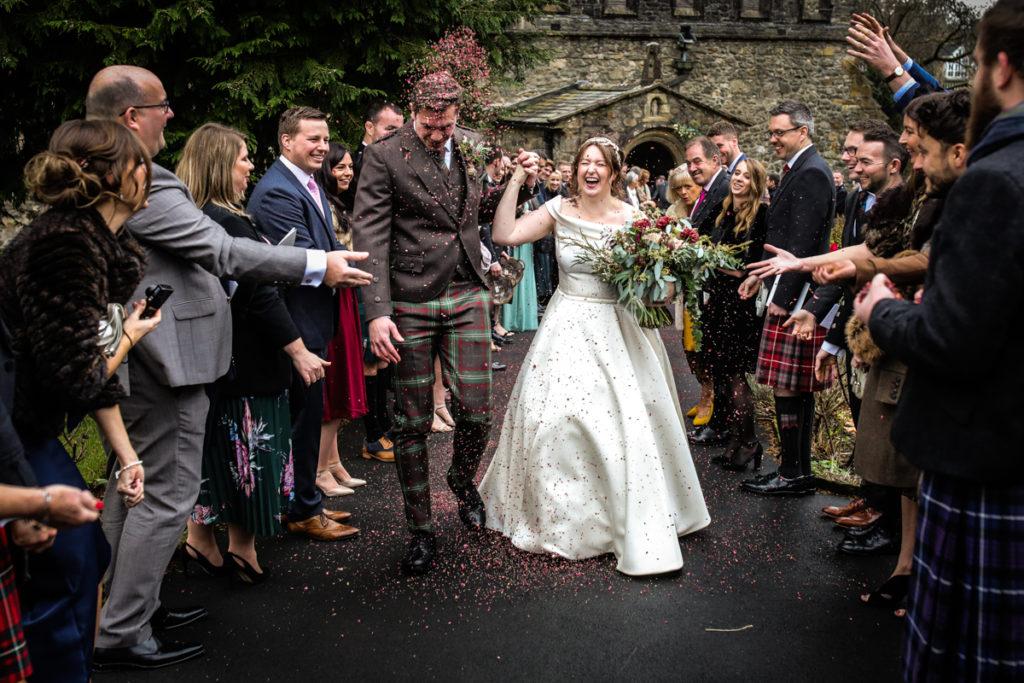 lake district documentary wedding photographer Sedbergh church wedding with confetti