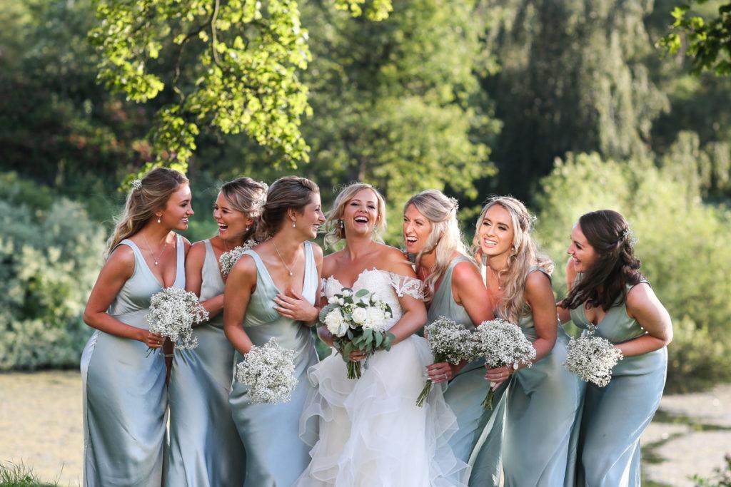 lake district documentary wedding photographer Greystoke Castle bridesmaids laughing