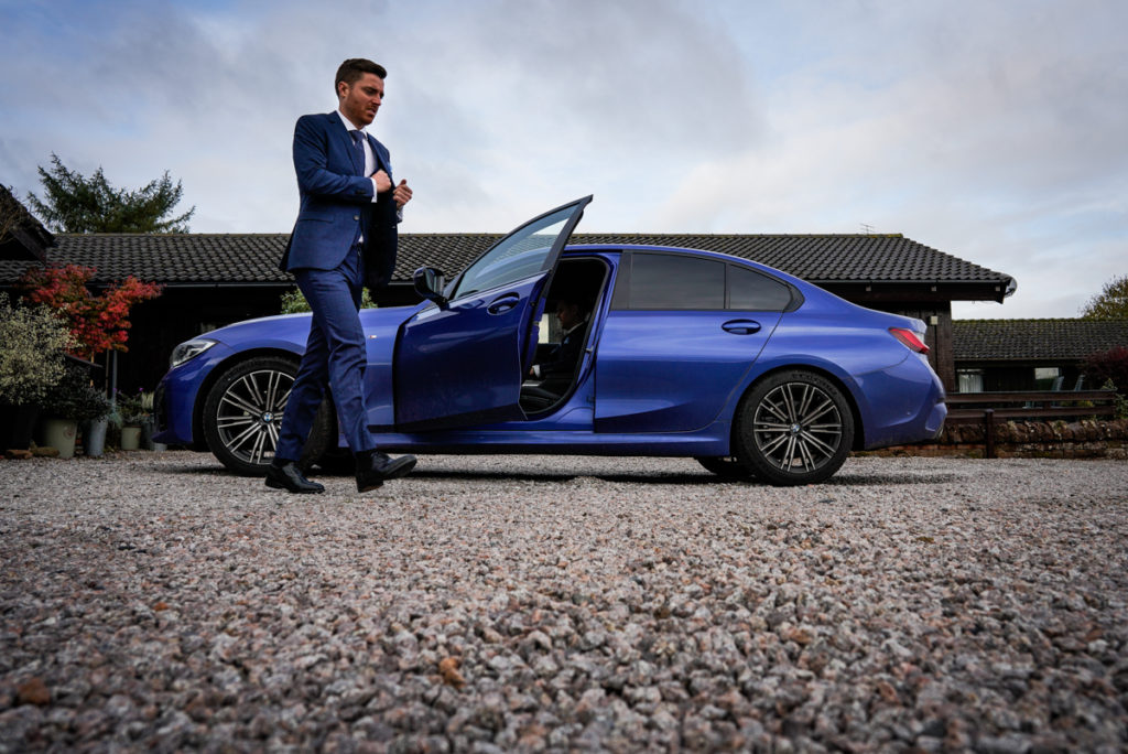 lake district documentary wedding photographer groom with blue car