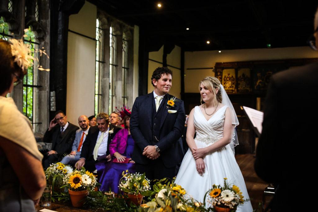 lake district documentary wedding photographer Samlesbury Hall vows laughing