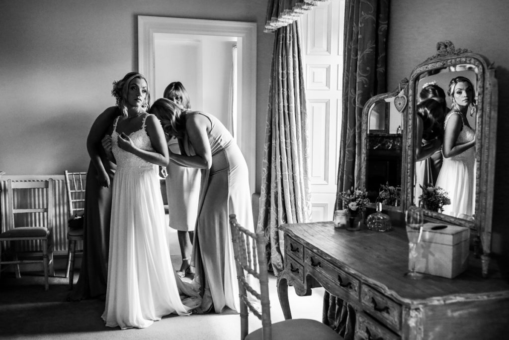 lake district documentary wedding photographer Springkell bridal prep in black and white