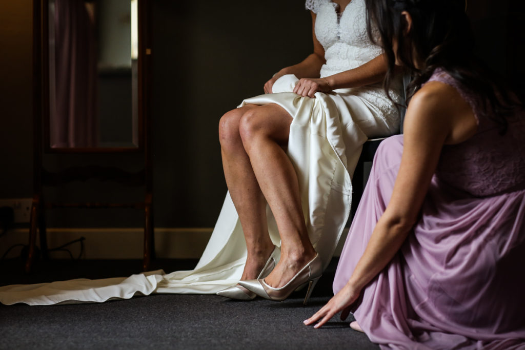 lake district documentary wedding photographer Askham Hall brides shoes