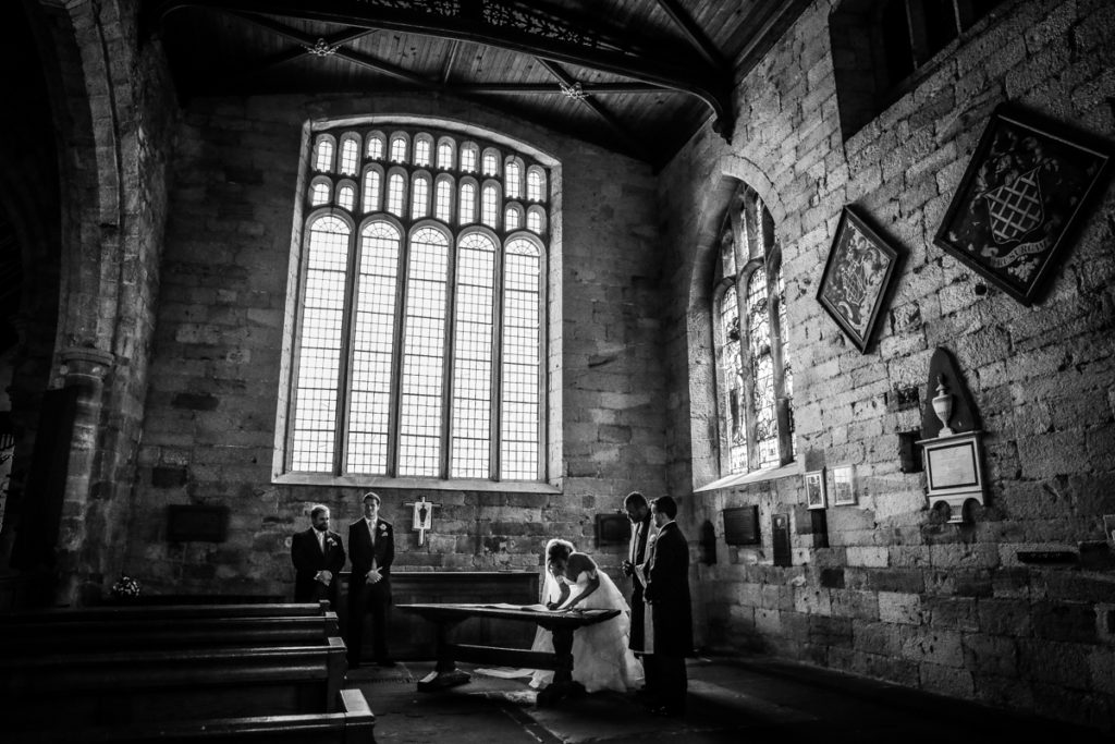 lake district documentary wedding photographer Church silhouette in church black and white