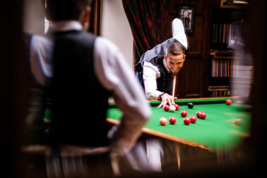lake district documentary wedding photographer Dundas Castle ushers playing billiards