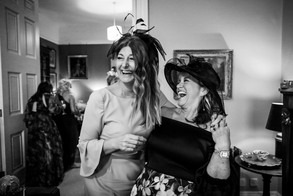 lake district documentary wedding photographer guests laughing black and white