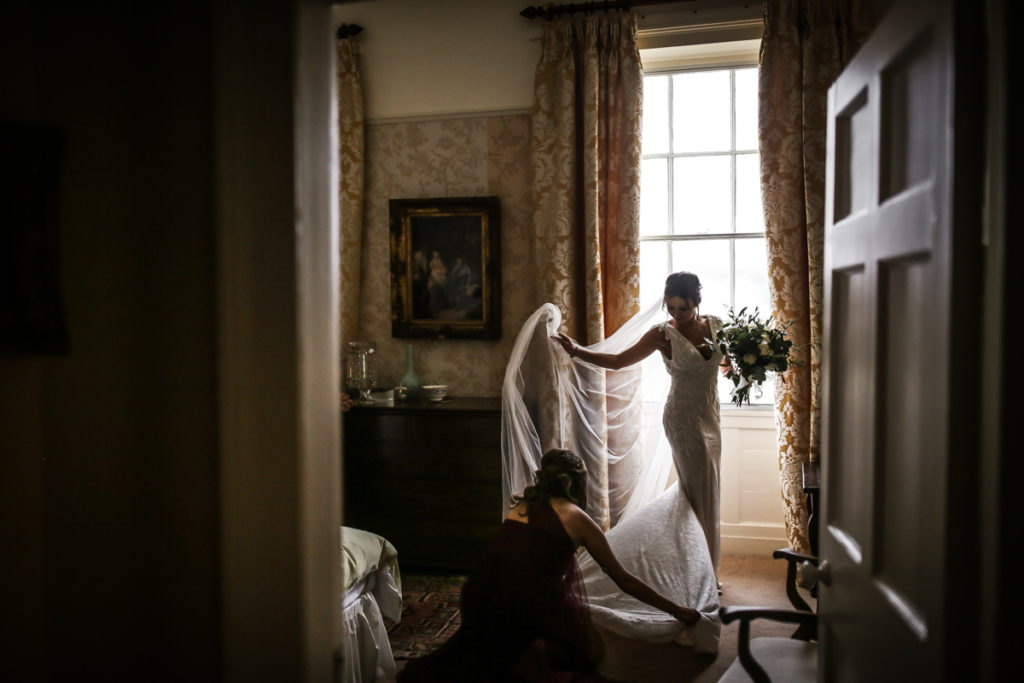 lake district documentary wedding photographer bride in window