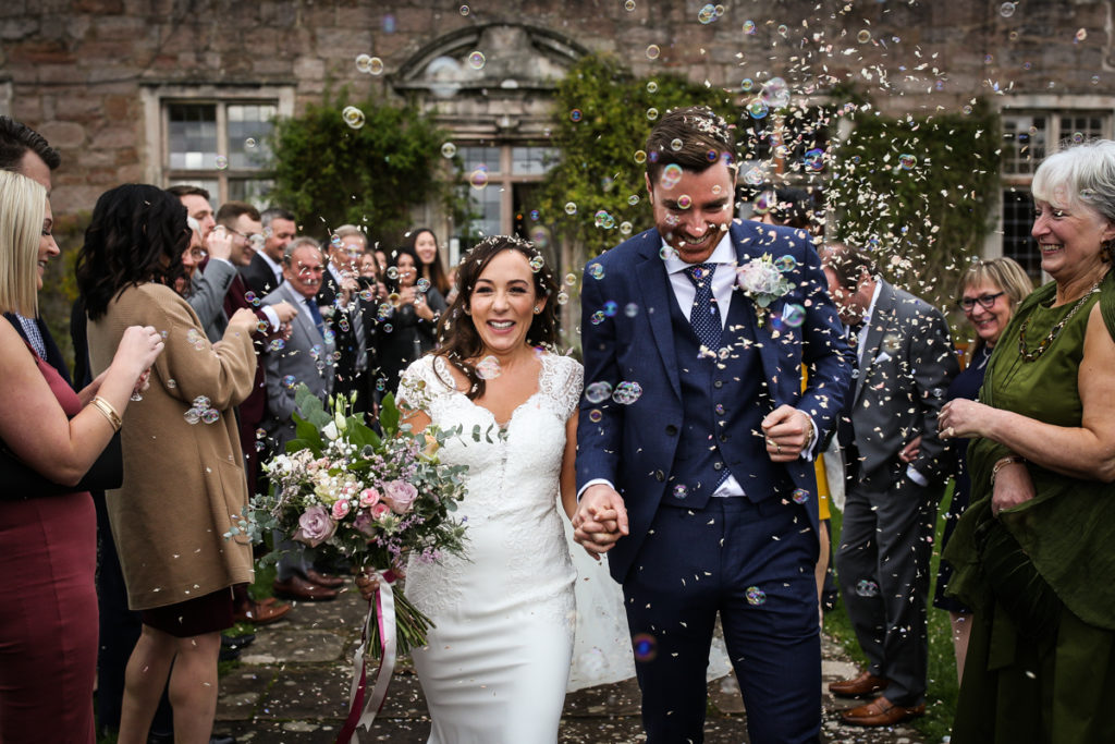 lake district documentary wedding photographer Askham Hall confetti and bubbles