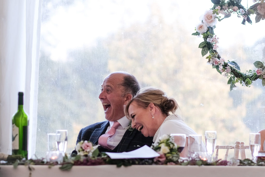 lake district documentary wedding photographer parents laughing at speeches