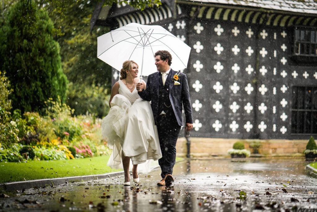 lake district documentary wedding photographer Samlesbury Hall couple in the rain