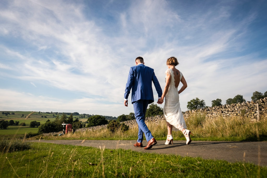 lake district documentary wedding photographer Knipe Hall couple walking in the summer