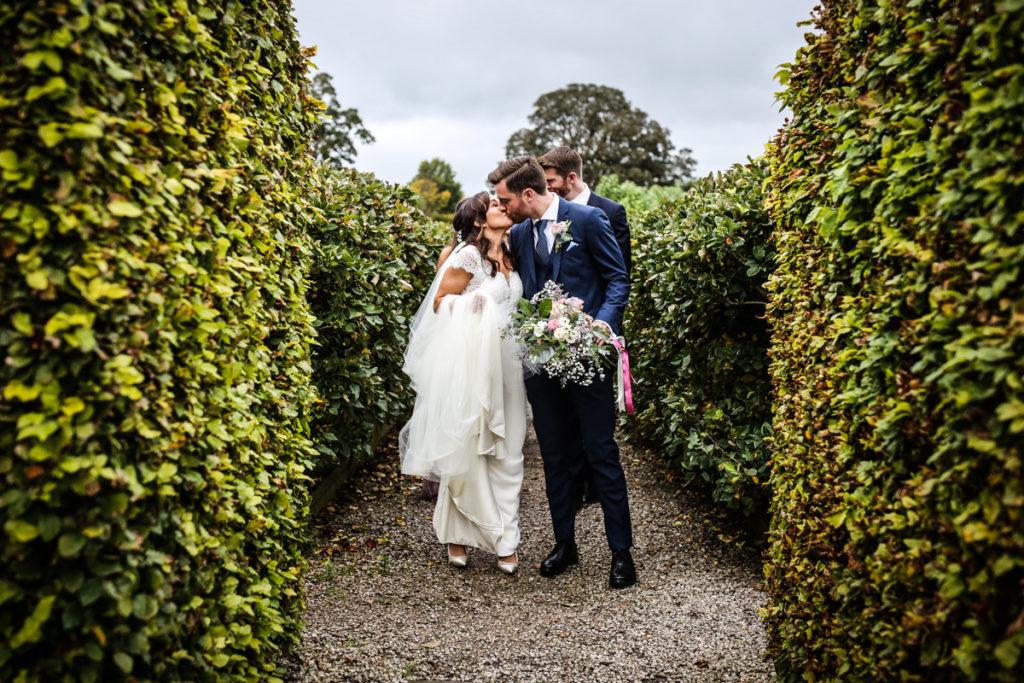 lake district documentary wedding photographer Askham hall couple kissing