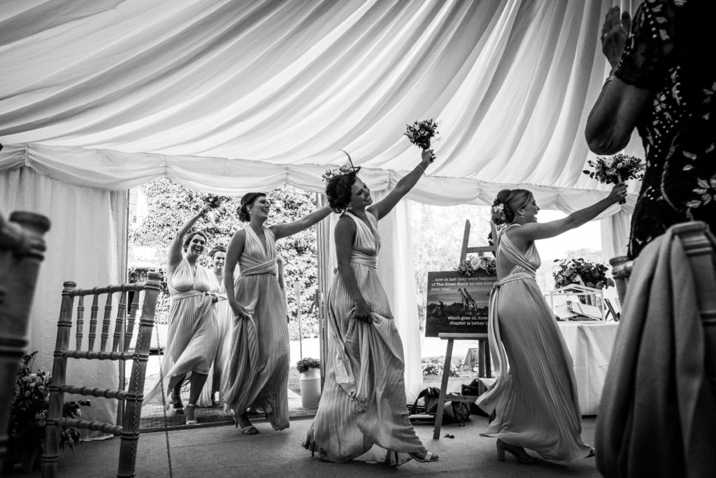 lake district documentary wedding photographer Low House bridesmaids entrance to the speeches black and white